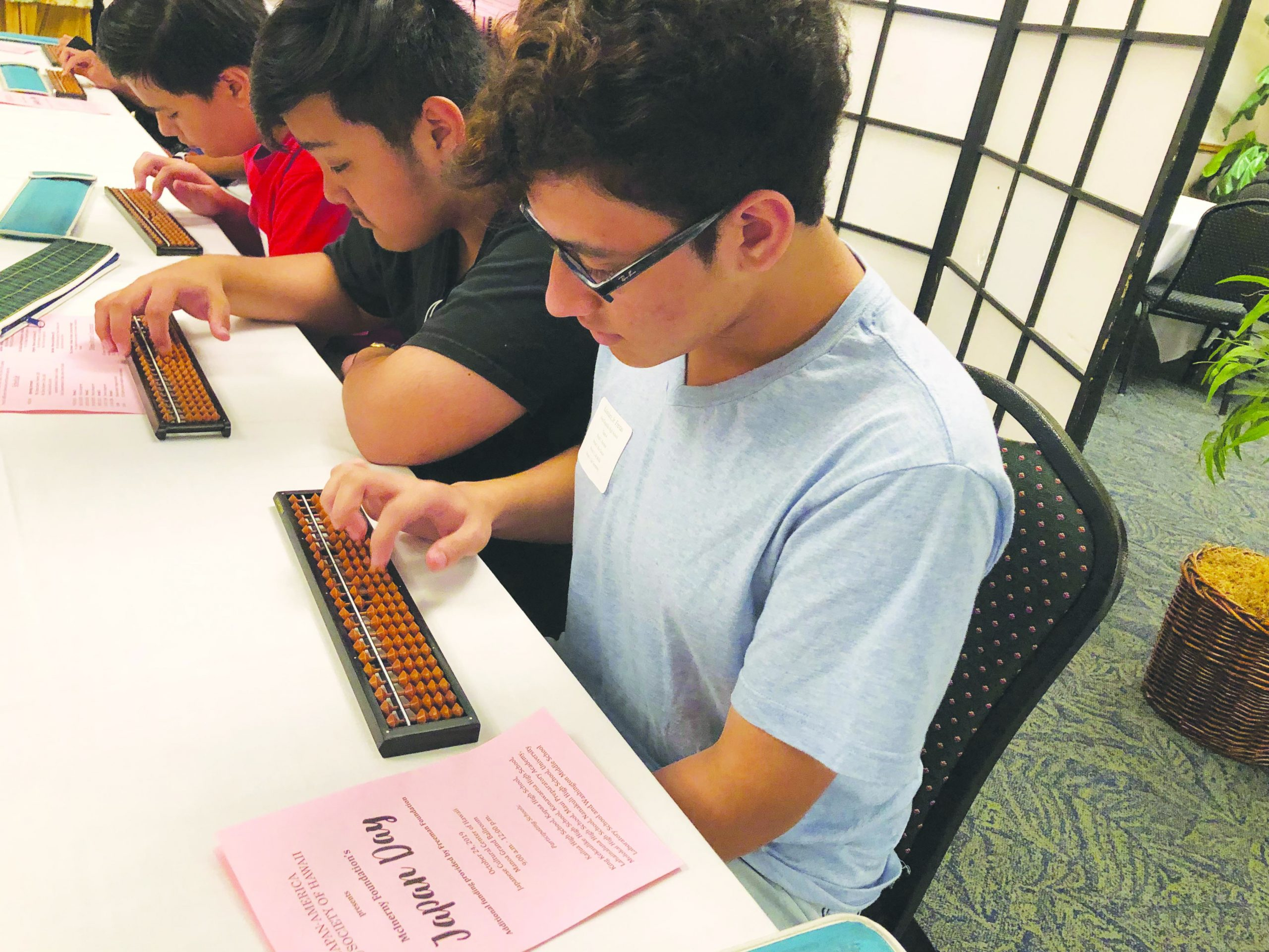 Kaleolani Freitas Jr. from King Kekaulike High School in Kula, Maui, practices calculating various math problems on the soroban, or Japanese abacus.