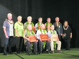 Standing, from left: Honolulu Mayor Kirk Caldwell and Gov. David Ige with 2019 HUOA Legacy Award honorees from Hawai'i — Arthur Kaneshiro, Roy Yamaguchi and George Tamashiro — along with deputy consul general of Japan Shinichi Yamanaka and 2019 HUOA president Jocelyn Ige. Seated (from left) are the Legacy Award honorees from Okinawa: Akira Makiya, Choko Takayama and Asami Ginoza.