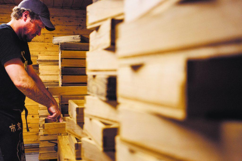 Stephen Lyman hard at work in a shöchü distillery in Japan. (Photo by Joseph Overbey, courtesy of Stephen Lyman)