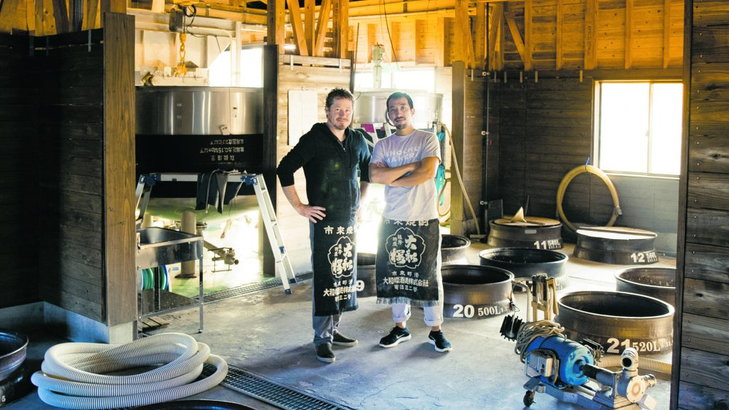 Stephen Lyman and his friend in a shöchu distillery. (Photo by Joseph Overbey, courtesy of Stephen Lyman)