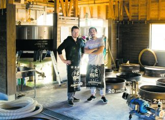 Stephen Lyman and his friend in a shöchu distillery. (Photo by Joseph Overbey, courtesy of Stephen Lyman)