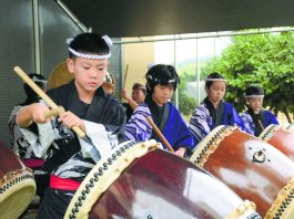 Children playing taiko drums at a New Year's Ohana Festival