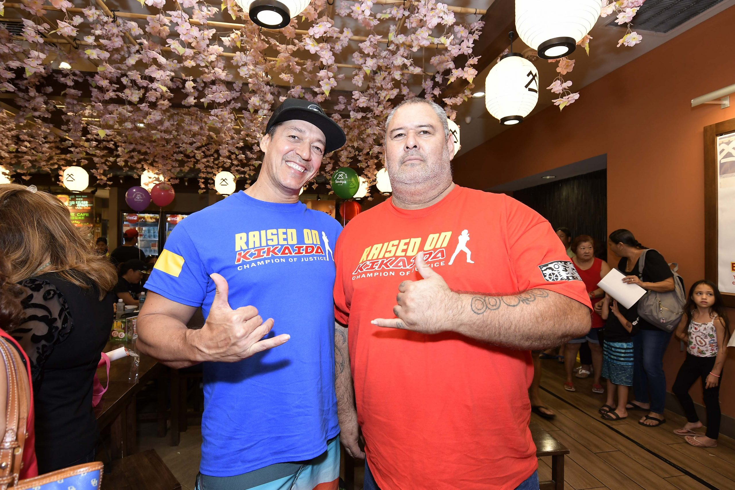 """Among the early fans of Kikaida were brothers Frank (left) and Mike Bortmas, who attended the event proudly wearing their """"Raised on Kikaida . . . Champion of Justice"""" T-shirts."""