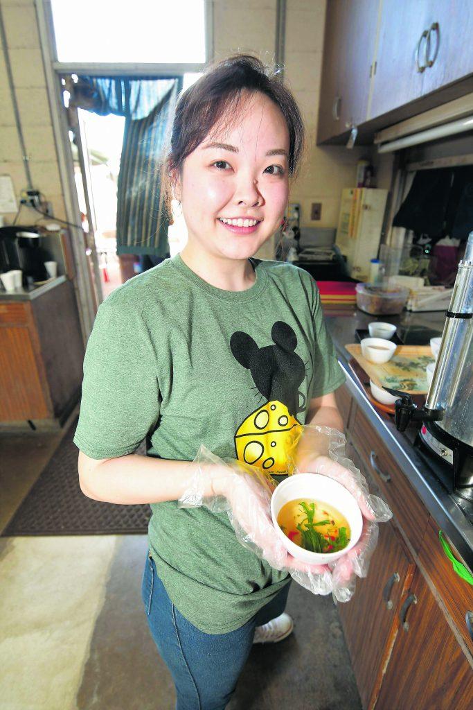 Sherri Miyakoda holds a bowl of ozoni (mochi soup) that visitors to Hawaii Kotohira Jinsha – Hawaii Dazaifu Tenmangu received at the shrine on New Year's Day.
