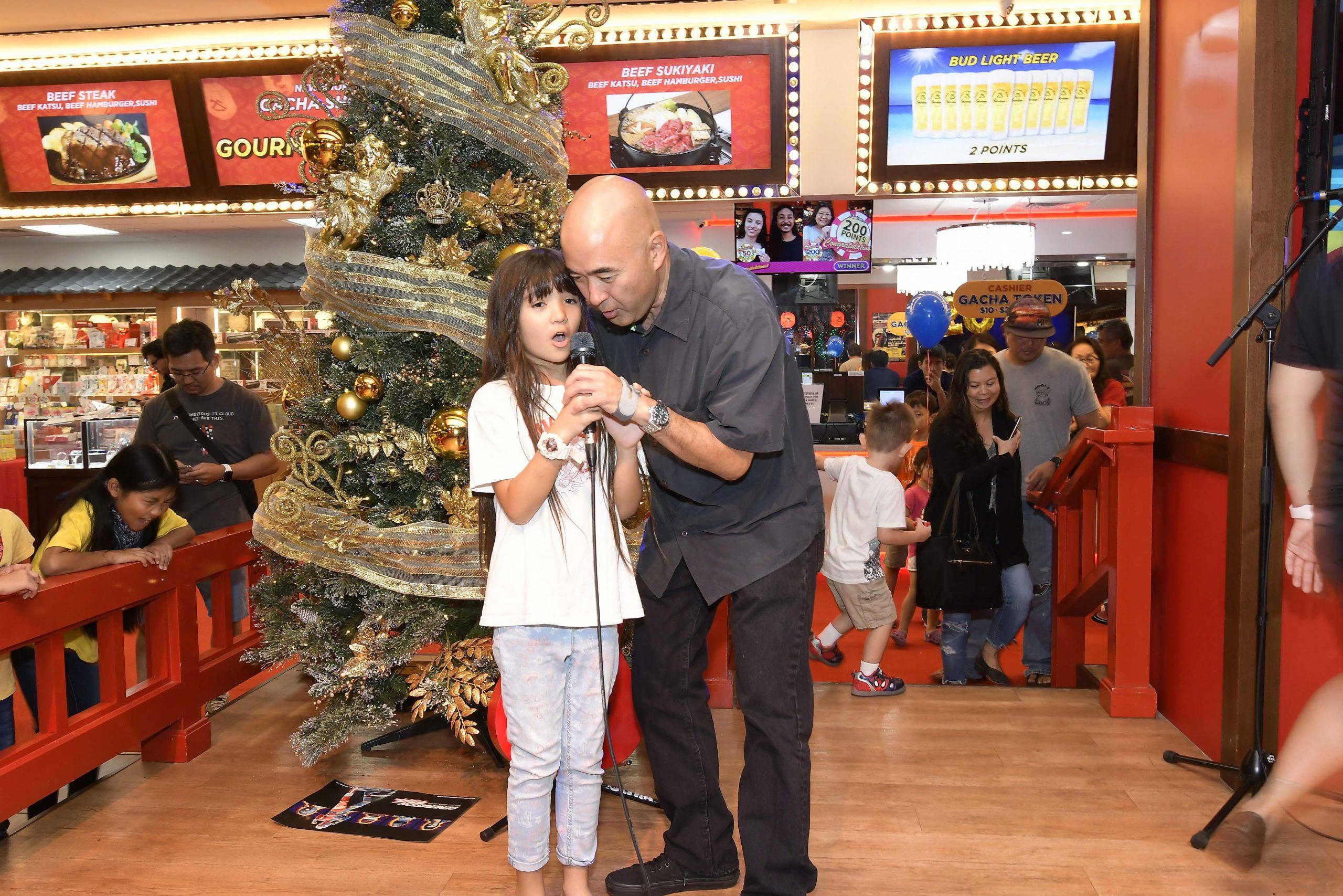 Kikaida fans Maggie Inouye and her dad Ken sing the Kikaida theme song together.
