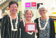 "From left: Poets Ann Inoshita, Jean Yamasaki Toyama and Juliet S. Kono with their Hawai'i Book Publishers Association Honorable Mention award for ""What We Must Remember"" on the Massie case. The volume was published by Bamboo Ridge Press. (Photo courtesy Joy Kobayashi-Cintron)"