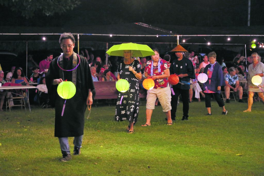 The Naalehu Hongwanji bon dance also included a lantern parade, which was led by the Rev. Satoshi Tomioka. The obon service was held earlier in the month. (Photos by Alan Kubota