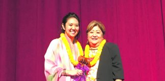 "Outgoing president Jocelyn ""Jo"" Ige presents the president's gavel to Lynn Miyahira."