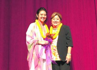 "Outgoing president Jocelyn ""Jo"" Ige presents the president's gavel to Lynn Miyahira."