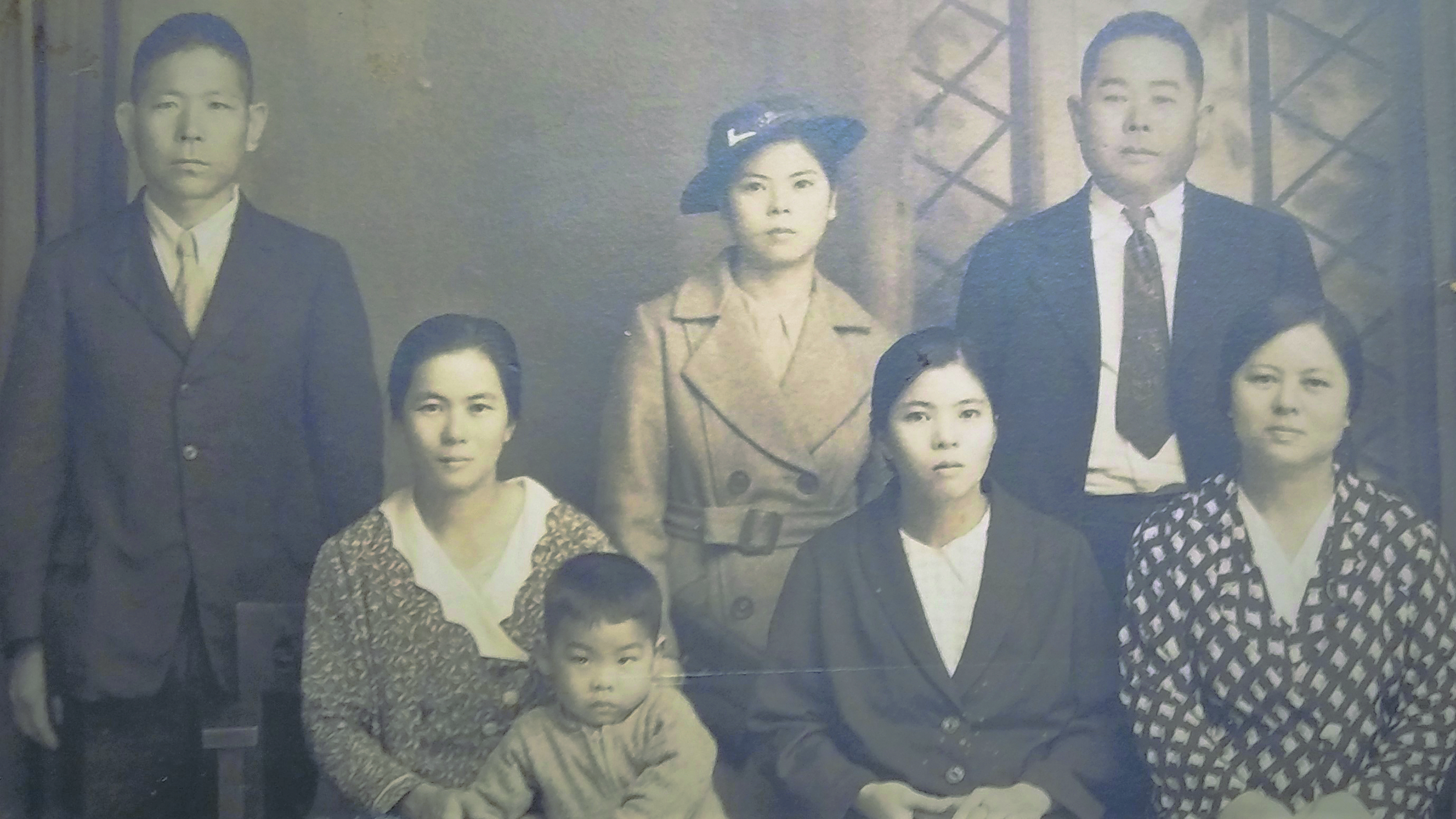 The family: (from left) Matsuni, Moto and little Takeo Nakasone with three of Moto's sisters and a brother in-law. (Black and white photos courtesy Takeo Nakasone)