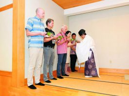 The Rev. Akihiro Okada of the Daijingu Temple in Nuuanu performed a Shintö blessing of Japanese Cultural Center of Hawai'i leaders and others in the martial arts dojo at the start of the Jan. 12 festival. The blessing also included the partaking of sake by JCCH president/executive director Jacce Mikulanec and board chair Ken Hayashida; Honolulu Mayor Kirk Caldwell; Mrs. Misako Ito, representing her husband Consul General of Japan in Honolulu Koichi Ito; and Kevin Asano, one of four Japanese American Olympians from Hawai'i. Asano captured a gold medal in the 1988 Olympic Games in judo.