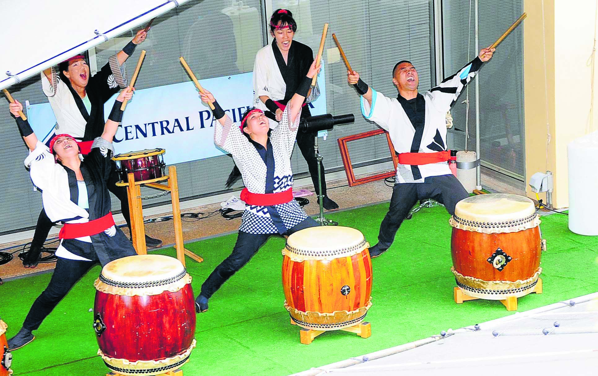 Ryugen Taiko members put all their energy into their performance.