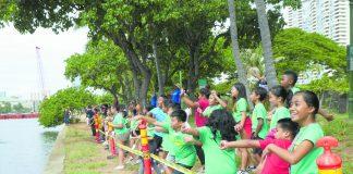 Ala Wai Elementary preschoolers throwing their Genki Balls into the Ala Wai Canal.