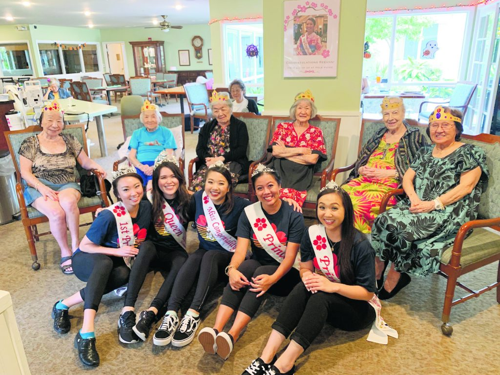 Visiting the residents of Hale Ku'ike Residential Home Care in Nu'uanu. From left: First Princess Kayla Ueshiro, Queen Lauren Sugai, Miss Congeniality Reeann Minatoya, Princess and Miss Popularity Taylor Chee and Princess Ariel Lee