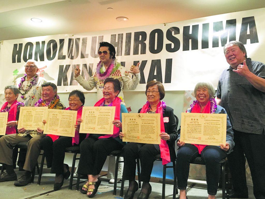 "Honolulu Hiroshima Kenjin Kai's proud new class of octogenarians (from left): Fumie Kitamura, George Kodama, Janette Nagao, Nancy Shimamoto, Lillian Uedoi and Shirley Yamada. Standing behind them are 80-year-old member recognition chair Kenneth Saiki (far left), ""Japan's Elvis"" — Toki Toyokazu and HHKK president Wayne Miyao."