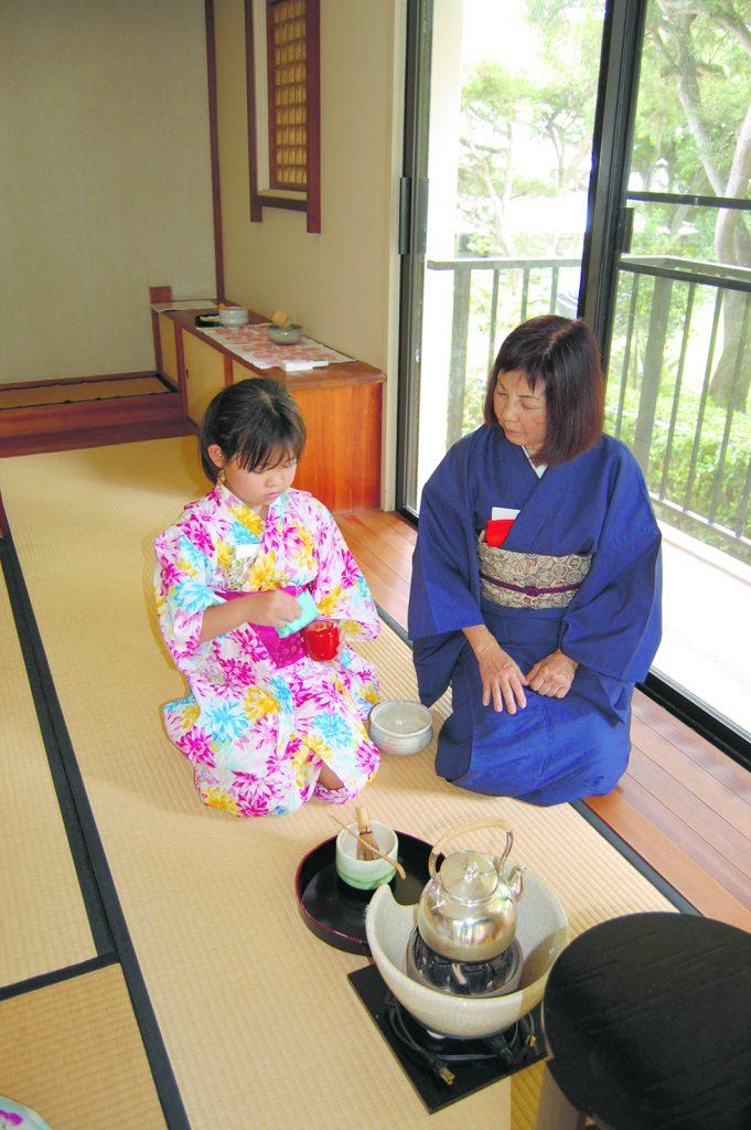 Marilyn Naka-Sensei and Jamelyn Tomori sit side by side as they begin to prepare tea