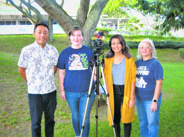Hiroaki Hara (left), originally from Okinawa and now studying at the University of Hawai'i, shared his perspective with Emily and Kehaulani. They are students of Kathy Shigemura (right) who teaches media at Kalaheo High School. (Photos by Dan Nakasone)