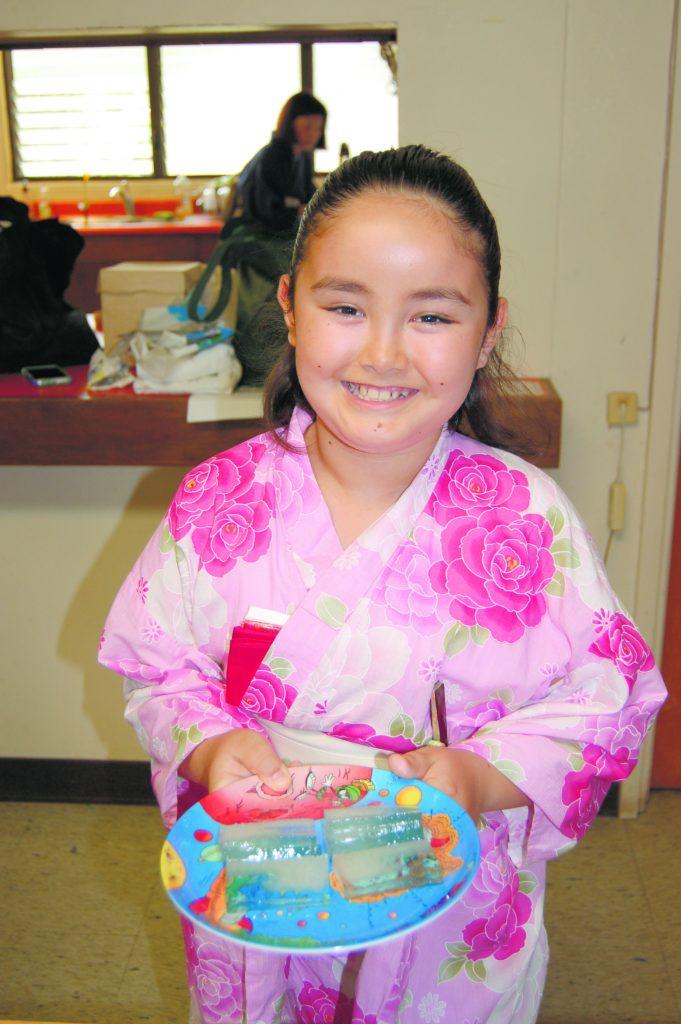 Yuu vanDeventer holds a plate of okashi (sweets) to enjoy for tea class.