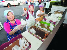 Sally Kageyama, Janet Ito and Zina Nagamine show off the fresh andagi for sale.