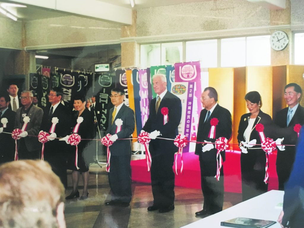 """In 2000, Irene Hirano (sixth from right) was among the dignitaries participating in the ribbon-cutting ceremonies opening the Japanese American National Museum's """"From Bentö to Mixed Plate: Americans of Japanese Ancestry in Multicultural Hawai'i"""" at the Okinawa Prefectural Museum. Also pictured, from right, are then-JANM board chair George Takei, then-Hawai'i Lt. Gov. Mazie Hirono, U.S. Sen. Daniel Inouye, U.S. Ambassador to Japan Thomas Foley and Okinawa Prefecture Gov. Keiichi Inamine. (Photo by Karleen Chinen)"""