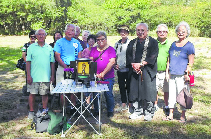 The Rev. Bert Sumikawa and a dozen members of the Windward Buddhist Temple held an obon service in June 2019 at the nearly one-acre Bellows Japanese Cemetery in Waimänalo. (Photo courtesy of Windward Buddhist Temple)