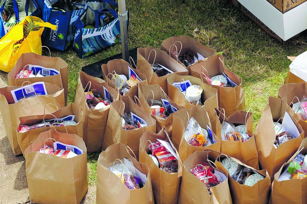 """Principal Carganilla put out a call for donations on Facebook. He said, """"Food came from everywhere,"""" including the Hawaii Foodbank."""