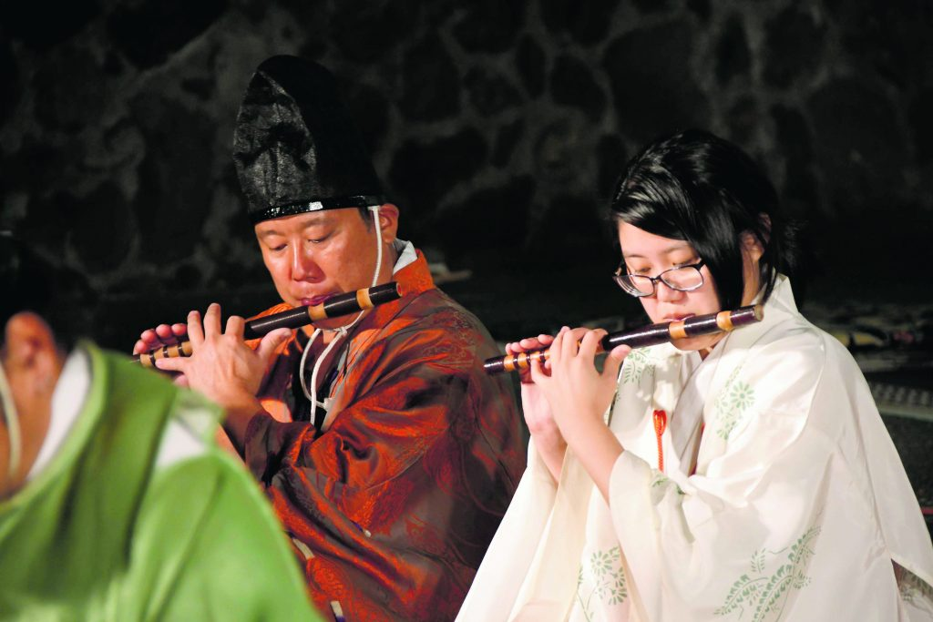 Ryüteki flute players Moses Nakao (left) and Blake Mio Shimabukuro.