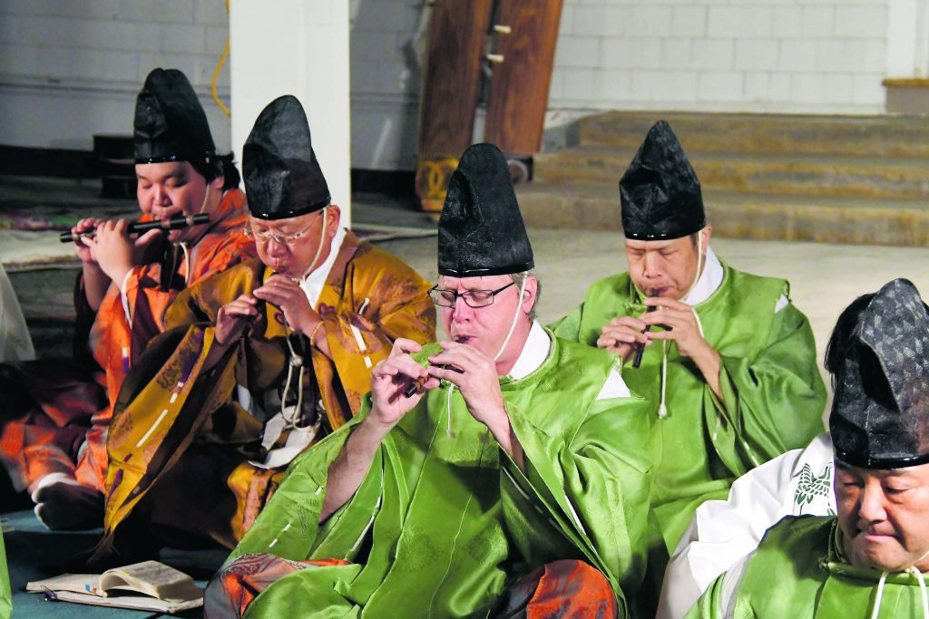 From left: David Shinsato playing the ryüteki while Kenjun Kawawata, Sam Schank and Kenneth Fong play the hichiriki.