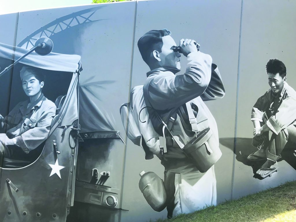 """Maui architect Jim Niess said artist Kirk Kurokawa painted the mural walls like their black and white original photographs, adding """"a subtle touch to its powerful imagery, giving the mural a true sense of integrity and connection to the past."""" (Photo by Melissa Tanji)"""