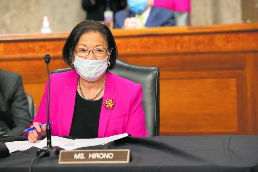 A cancer survivor in her 70s facing higher-than-normal risk of COVID-19 fatality, thesenator persists inrepresenting Hawai'iin Congress, making her voice heard about the virus's effects on the most vulnerable. On May 6, sheattended a Senate Armed Services Subcommittee meeting, mask on.(Photos courtesy of theOffice of Sen. Mazie K. Hirono.)