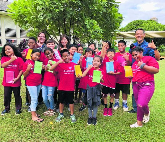 "Fourth graders from Ala Wai Elementary School show off their ""Aloha Journals"" with their teacher, Lori Kwee (back center), Principal Michelle DeBusca (back left) and Danny Kim (far right). (Photos courtesy of Danny Kim)"