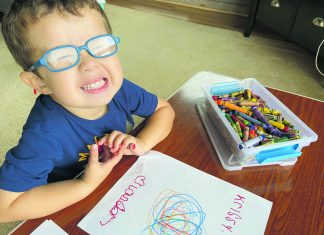 Three-year-old Landon Fox writing letters to his preschool friends. (Photo by Catherine Toth Fox)