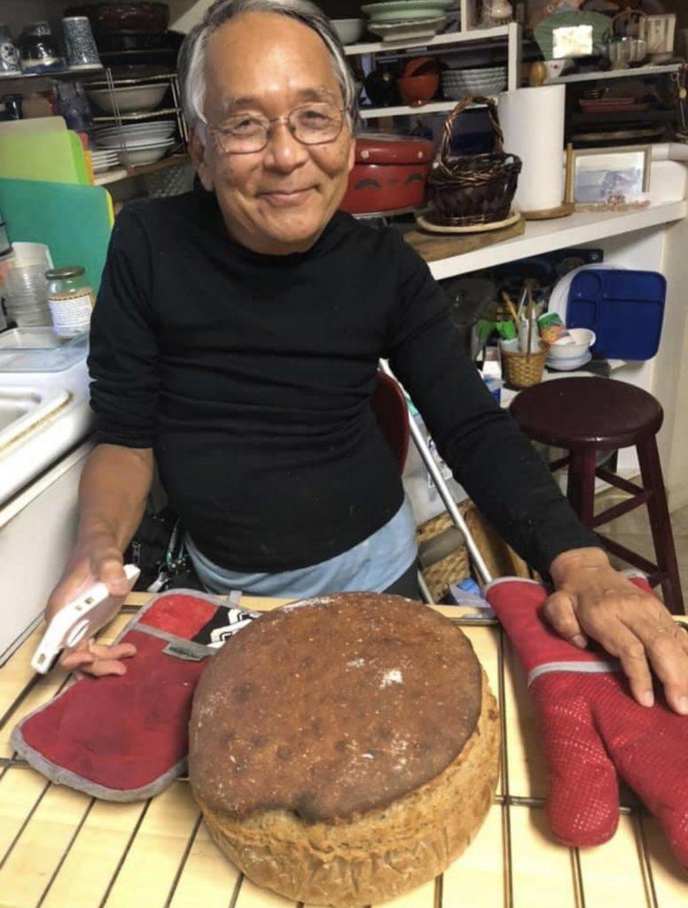 Retired professor from Kapi'olani Community College, Robin Fujikawa, with his homemade rye bread. (Photo by Linda Fujikawa)