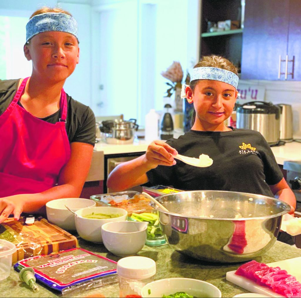"Kaialea and Lehia Tanner of Kane'ohe set up their stay-at-home sushi bar. ""Irasshaimase!"" (Photo by Bonnie Kahapea)"
