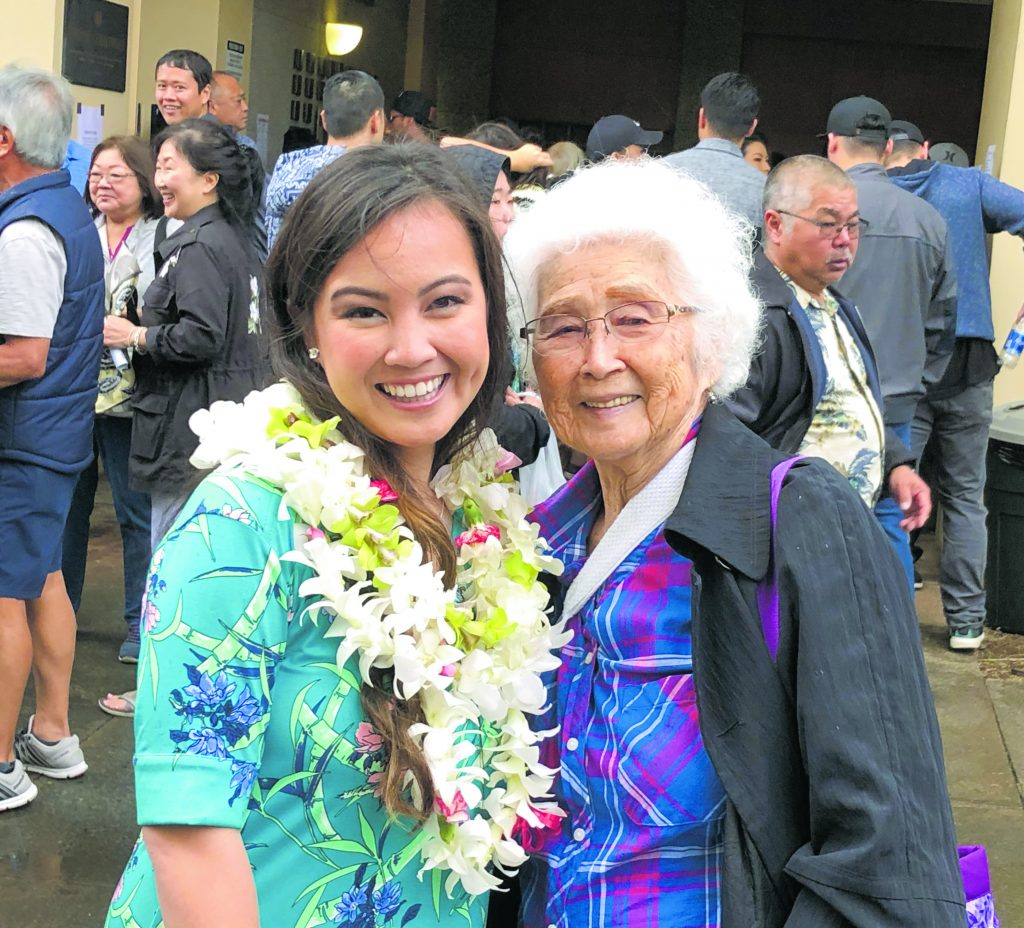 Jewel Mahoe and grandmother, Ann Lam (maiden name Nakai), at theCherryBlossomFestival Opening Ceremonies at the Japanese Cultural Center of Hawaiʻi's ʻOhana Festival in January. Sansei Lam's love for the CB Festival inspired her granddaughter to enter the contest. (Photo provided by Jewel Mahoe)