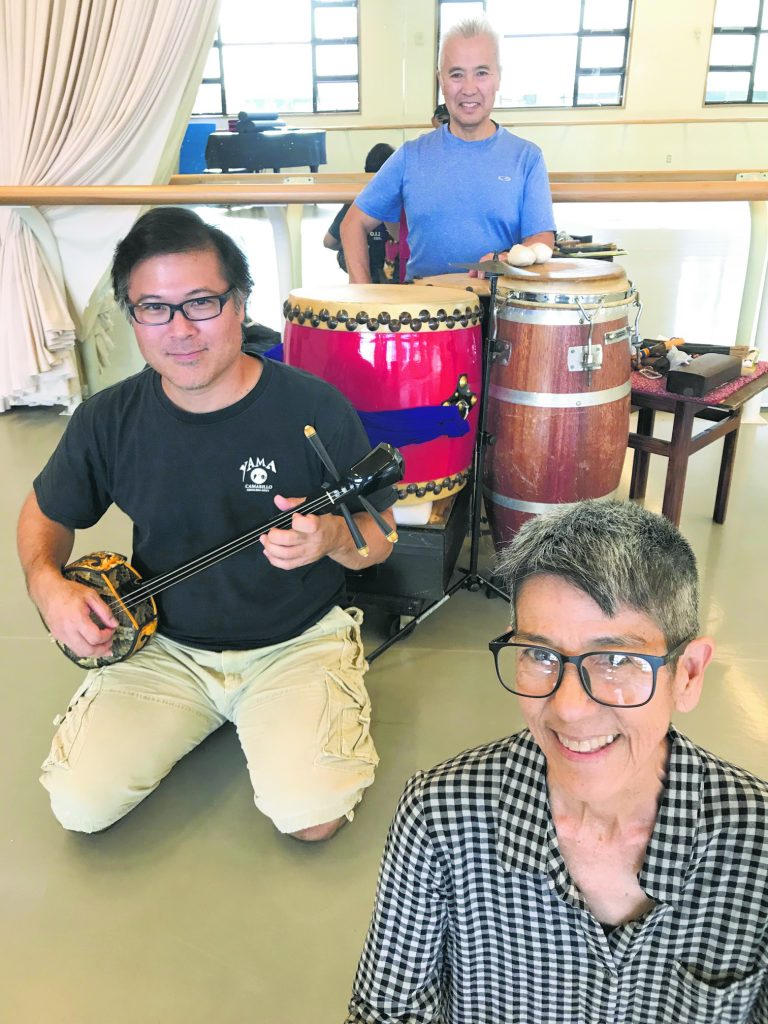 """Shiroma (foreground, right) and """"Imaginary Homelands"""" collaborators Kenny Endo (background) and Norman Kaneshiro (midground, left) during a 2020 rehearsal for their 2021 show at Leeward Theatre."""
