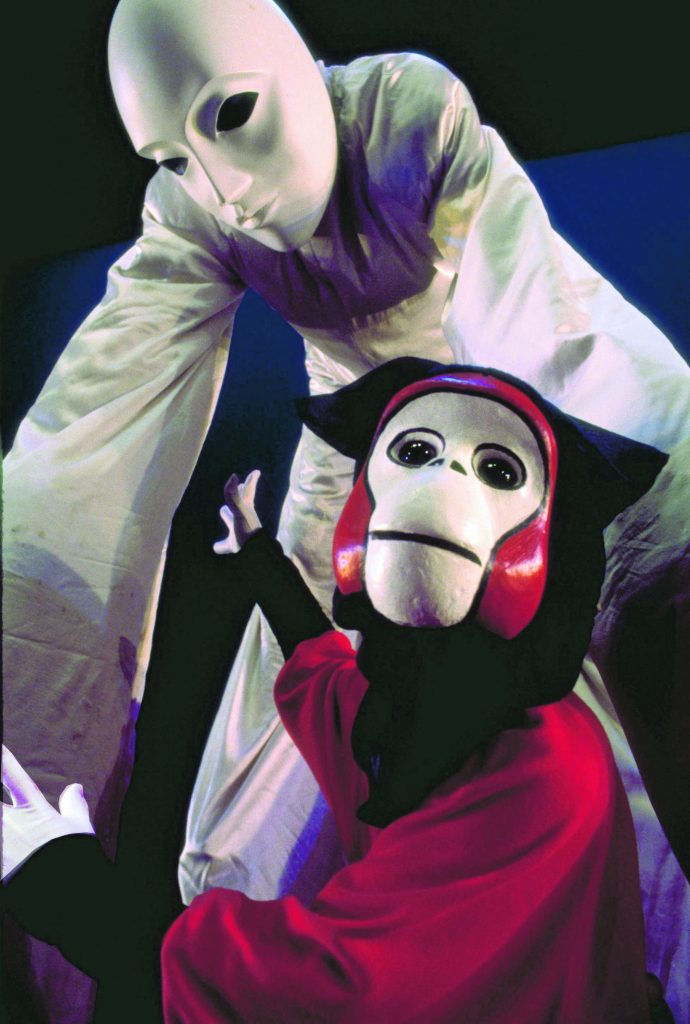 """""""Monkey and the Waterfall,"""" the titular piece after which the mask-performance company Monkey Waterfall — co-founded by Shiroma and Ben Moffat (and later joined by Michael Harada) — had been named. The piece was performed by Shiroma (bottom) and Moffat (top) at Scotland's Edinburgh Fringe Festival (1998)."""