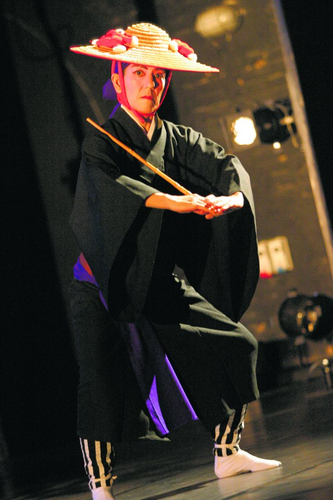 """Shiroma donning a traditional kimono for her performance in """"Manzai,"""" a classical male dance from a kumi wudui (Okinawan dance drama) about two brothers avenging their father's death. Photo taken at the Malaysian Dance Festival in Kuala Lumpur (2005)."""