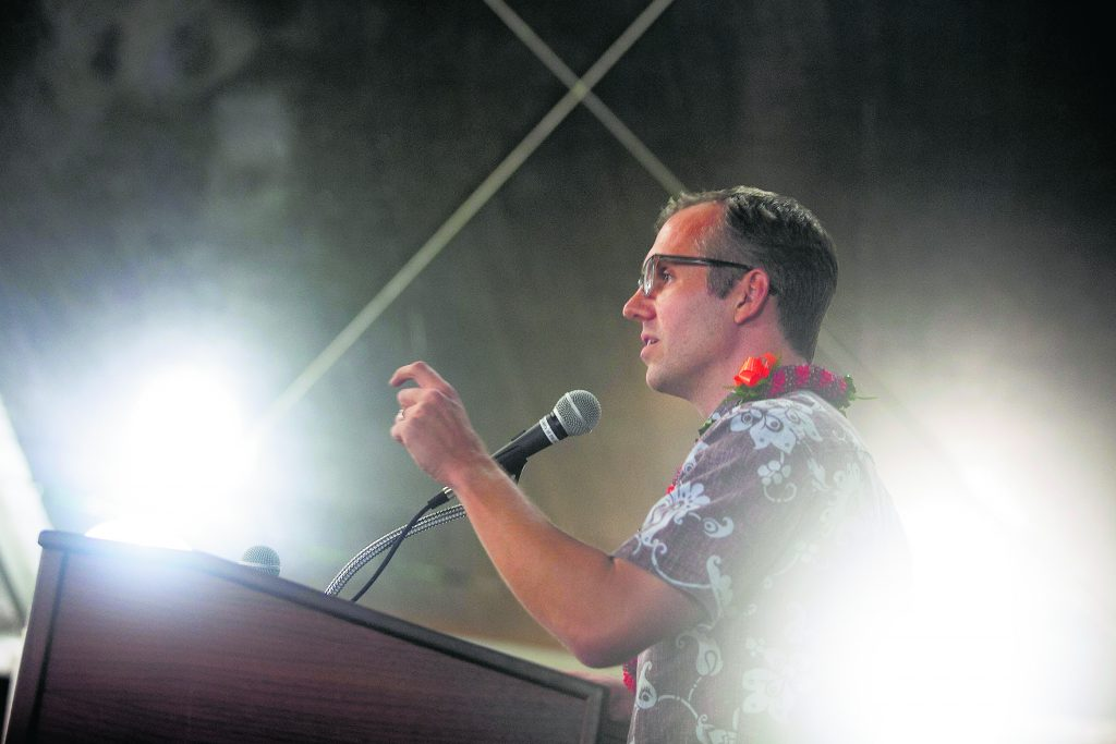 "Hawai'i Appleseed Center for Law and Economic Justice Executive Director, Gavin Thornton, addresses the Center's community partners at a Nov. 2018 ""Artists for Appleseed"" fundraiser. (Photo courtesy of Will Caron / Hawaiʻi Appleseed Center)"