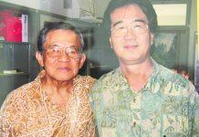 Longtime friends Jon Shirota and Professor Katsunori Yamazato. Yamazato is a retired president of Meio University in Nago, Okinawa. (Photo by Barbara Shirota)