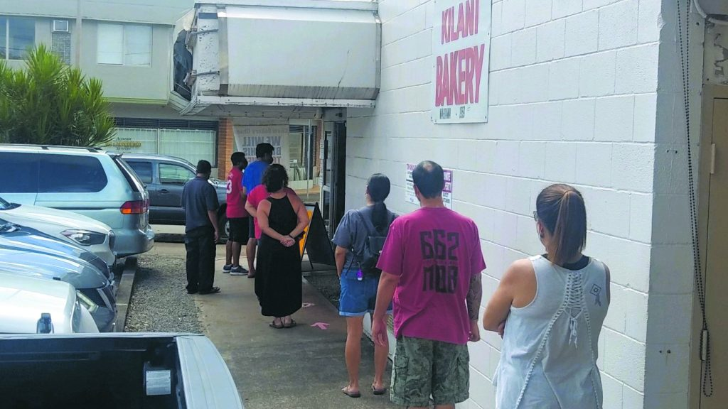 Customers line up outside of Kilani Bakery