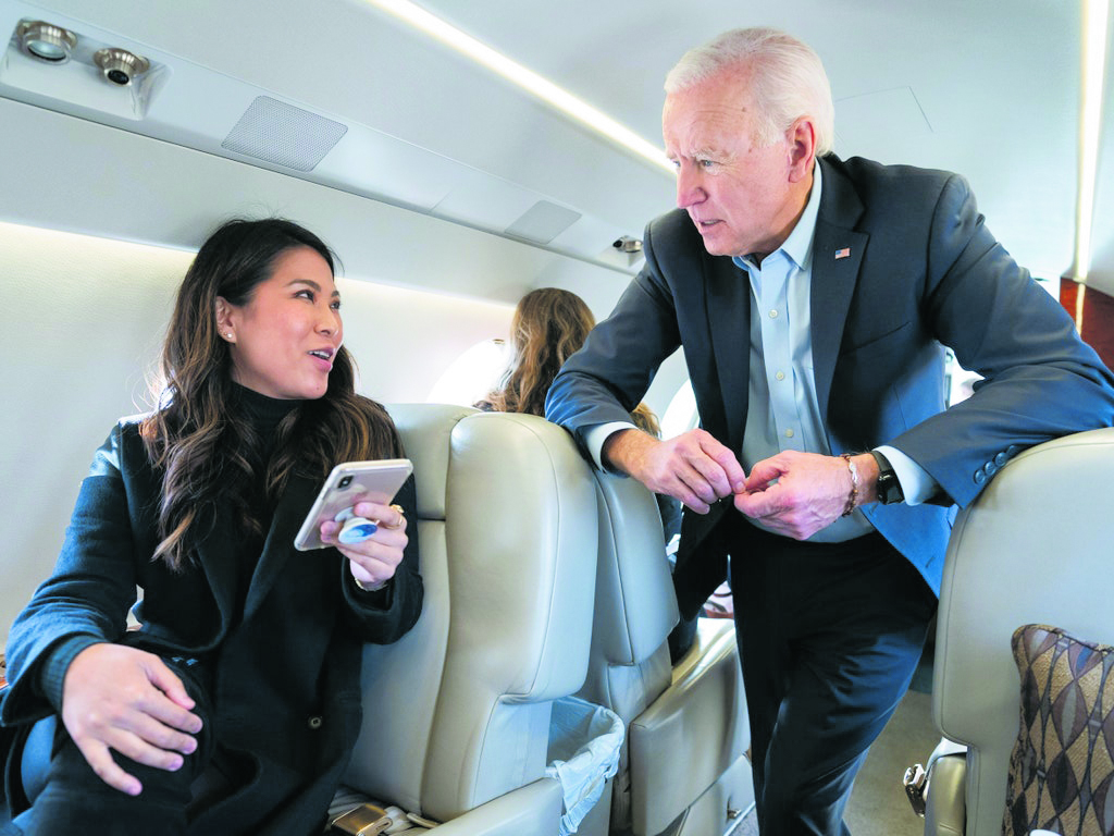 Remi Yamamoto talking with then-Presidential candidate Joe Biden during his campaign. This photo was criticized by supporters of Pres. Donald Trump, because both people were not wearing a mask; however, it was taken in November 2019, before COVID-19 was identified as a health threat. (Photos from Vogue magazine)