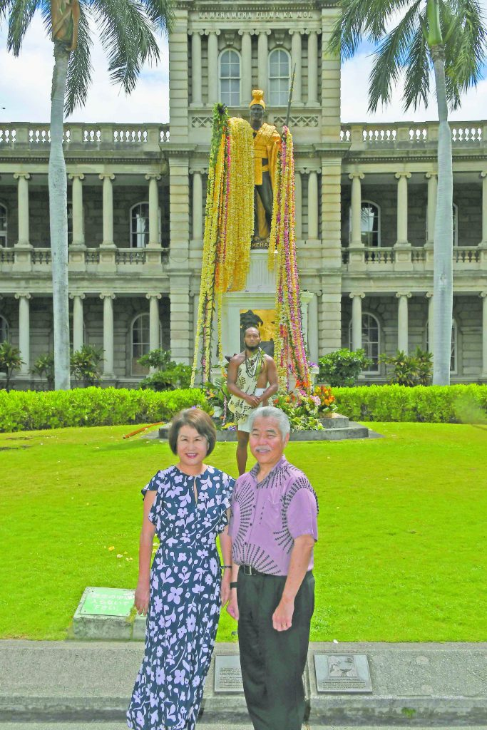 Gov. David Ige and First Lady Dawn Amano-Ige attended the King Kamehameha Day ceremony. Elijah Kala McShane, who participated in the ceremony, stands in the background.