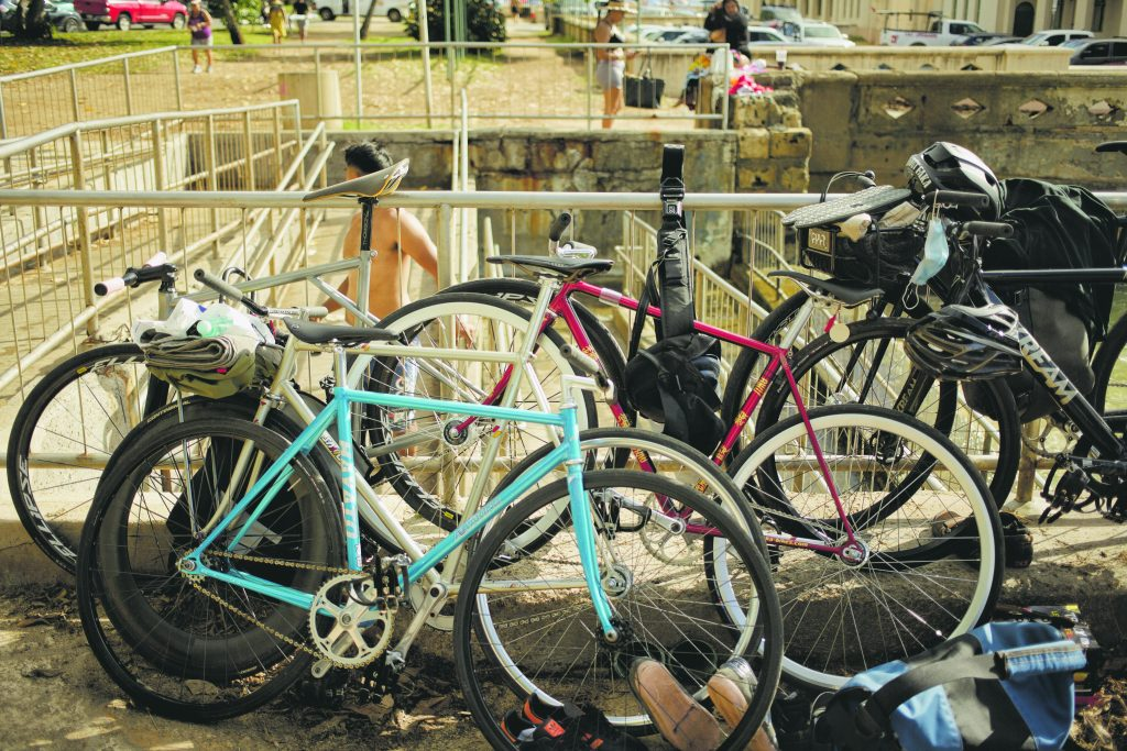 A tribe of track bikes take a rest near the Waikiki Natatorium War Memorial.